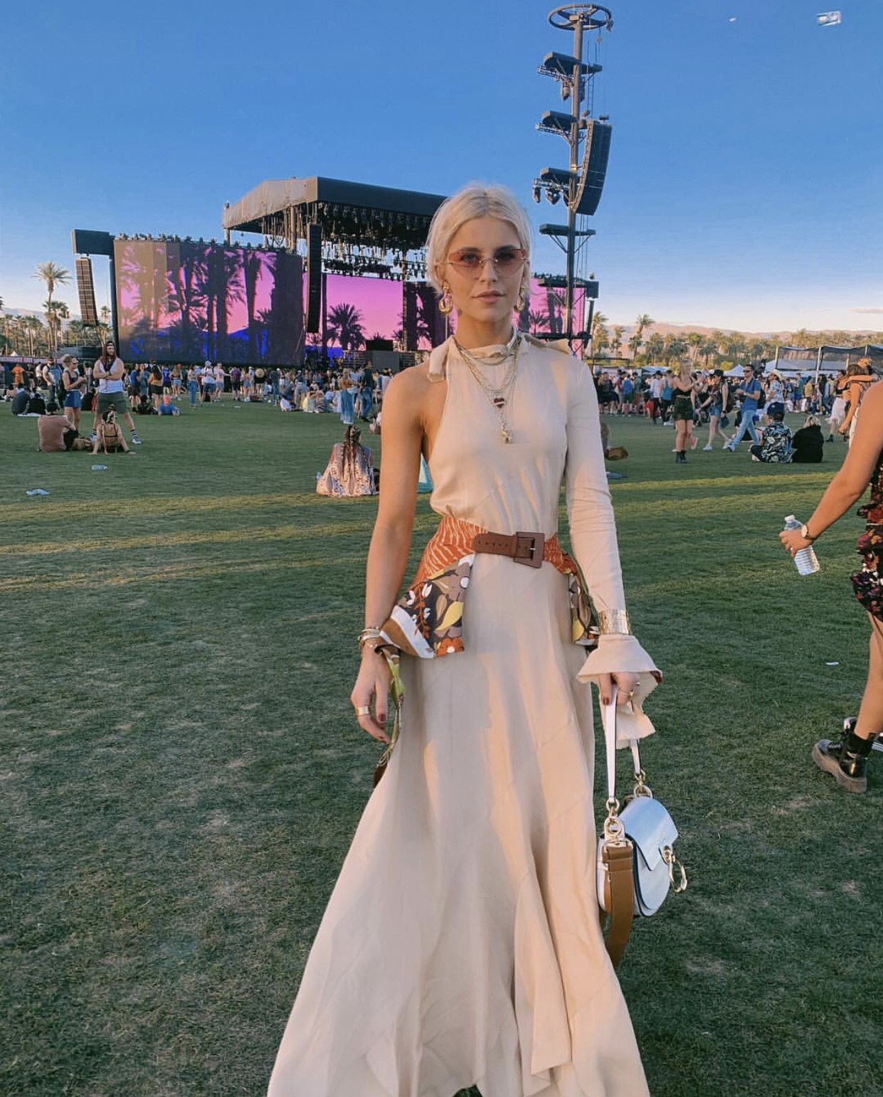 Coachella festival, and is located in a batik dyed bohemian jumpsuit.